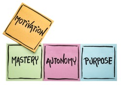 three elements of true motivation - mastery, autonomy, purpose - - handwriting in black ink on isolated sticky notes