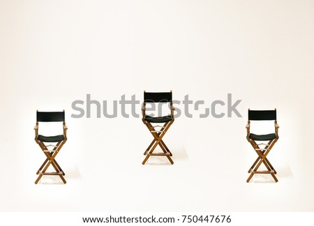 Three empty (blank, vacant, hollow) directors chairs isolated on the white background at the studio. Space for text. Vacant chair. The concept of selection and casting. #750447676