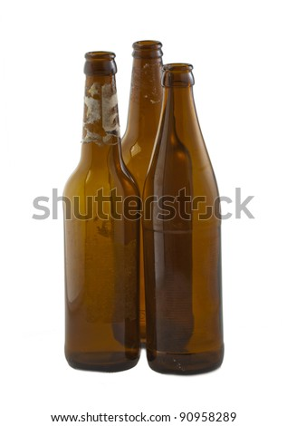 Three empty bottles of beer over white background