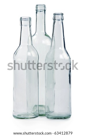 Three empty bottles on a white background