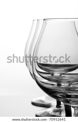 Three empty cognac glasses in a row