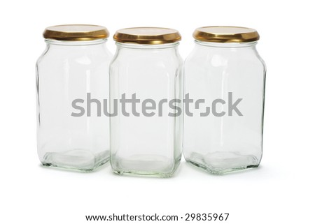Three empty glass containers on white background
