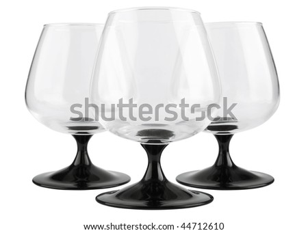 Three empty glass footed tumblers for brandy