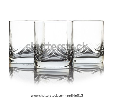 Three empty glass for whiskey over white background