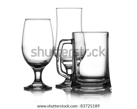 Three empty glasses of beer