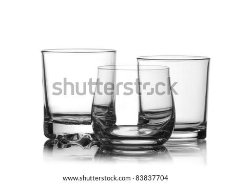 Three empty whiskey glasses - stock photo