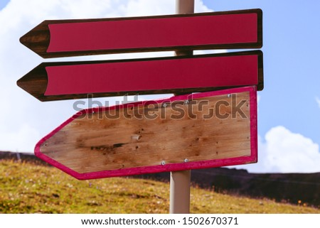 Three empty wooden direction signs pointing left