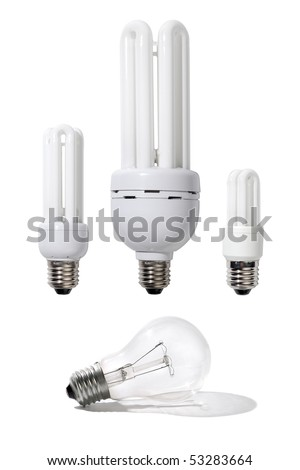 Three energy efficient light bulbs of different power and a regular light bulb isolated on white background