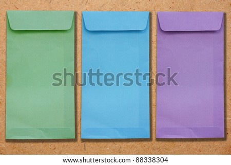 Three envelopes on the plywood.