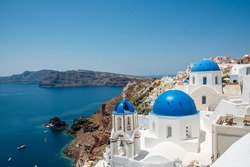 Three famous blue domes of Santorini Oia in one photograph.