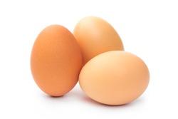 three farm brown chicken eggs on a white background