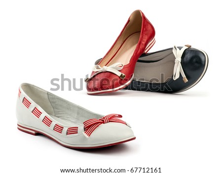 Three female flat shoes over the white background - stock photo