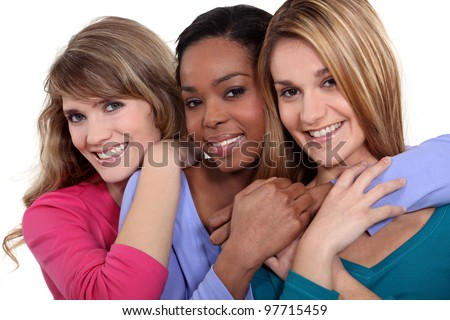 Three female friends stood in a row