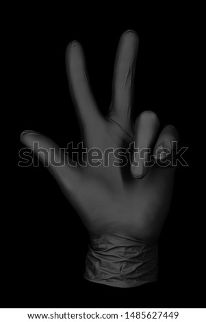 three finger black glove / isolated glove black background