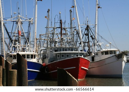 Three fishing trawlers tied to the moor at days end