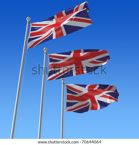 Three flags of UK against blue sky.