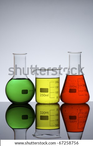 three flasks  for laboratory measurement of  liquids