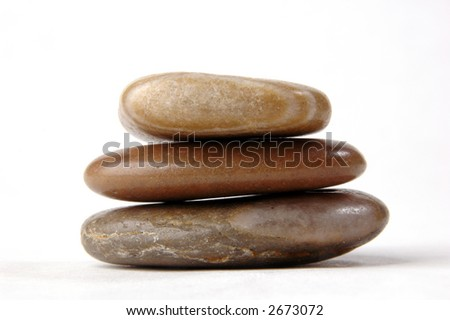 Three flat stones, balanced