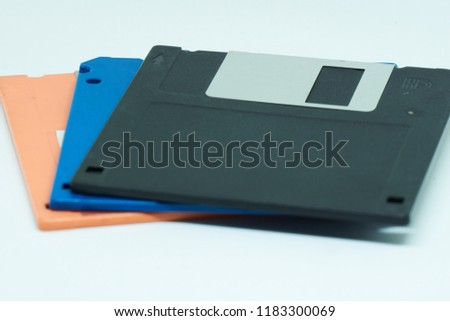 Three floppy disks or diskette in white background. It is a type of disk storage composed of a disk.