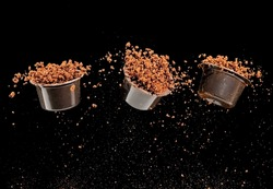 Three flying capsules full with instant coffee