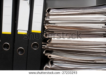 Three folders and pack of documents