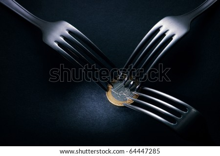 Three forks fighting over one euro coin , financial crisis competition ,dark background