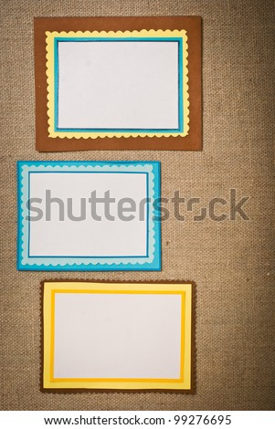 Three frames of colored paper