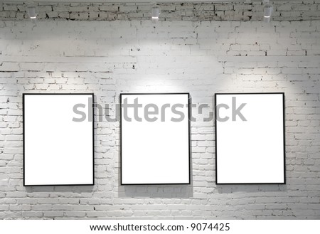 three frames on brick wall