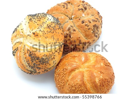 Three fresh baked buns with sesame seed, poppyseed and linseed