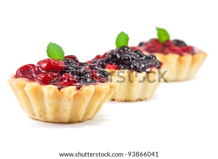 Three fresh blackberry and raspberry cakes