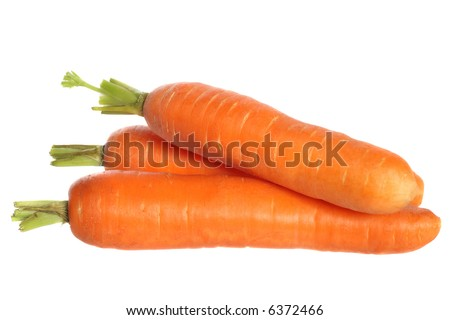 Three fresh carrots, isolated on white background