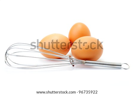 Three fresh eggs with whisk on white background.