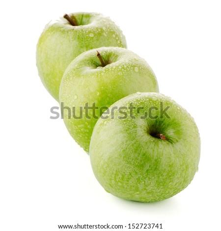 Three fresh green apples on white background.