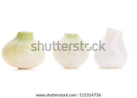 three freshly peeled white onions on white background
