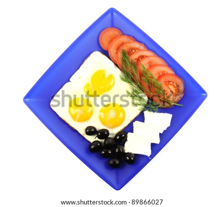 Three fried eggs on a blue plate, on a white background
