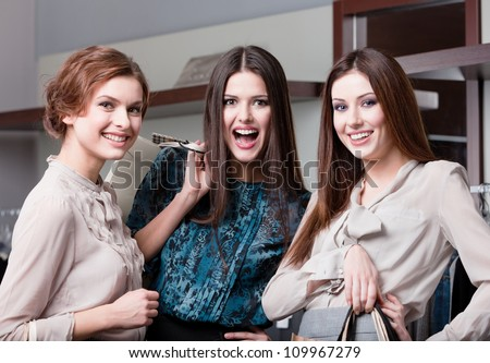 Three friends are happy after purchasing