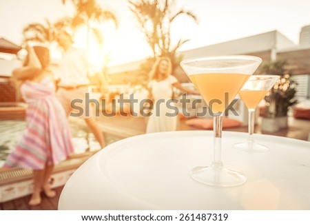 three friends having party in a lounge open disco. concept about entertainment and party