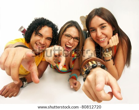 Three friends sharing and smiling on white background.