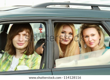 Three friends sitting in a  car