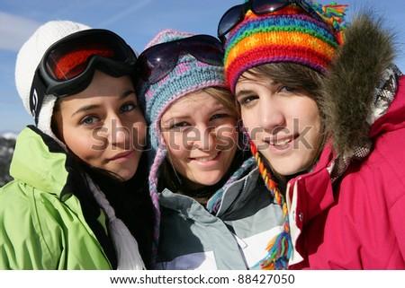 Three friends skiing