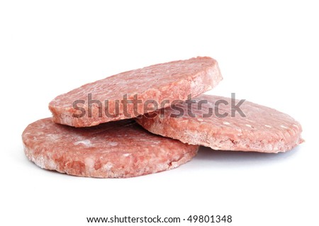 Three Frozen Hamburger Patties Isolated on White Background