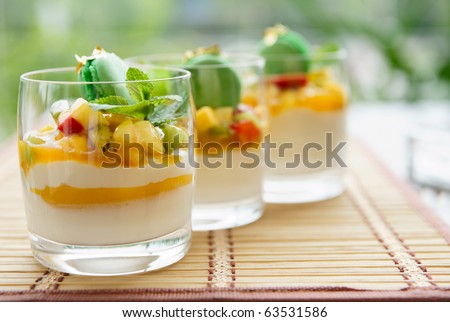 Three fruit cocktails in a summer restaurant lounge - stock photo