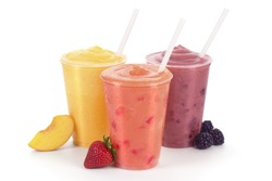 Three Fruit Smoothies or Shakes with Straws and Garnishes on a White Background