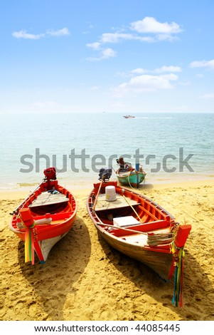 Three fshing boats close-up at sandy beach #44085445