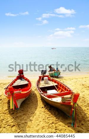 Three fshing boats close-up at sandy beach