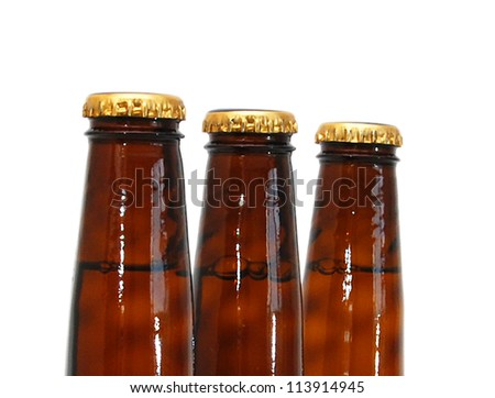 Three full beer bottles isolated on white.