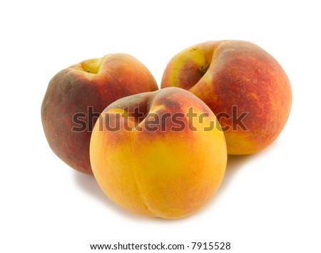 three full peaches isolated on white background