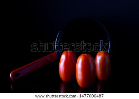 three funniest Italian tomatoes over black background - Funny Italian Tomato Stock fotó ©
