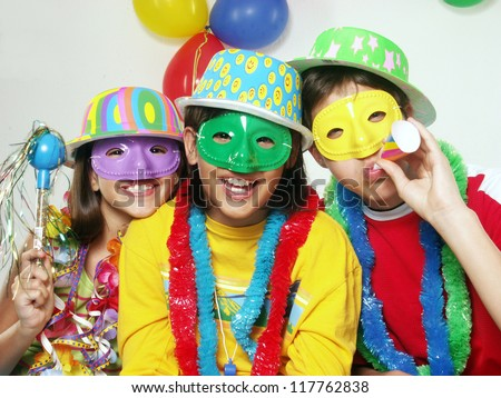Three funny carnival kids portrait - stock photo