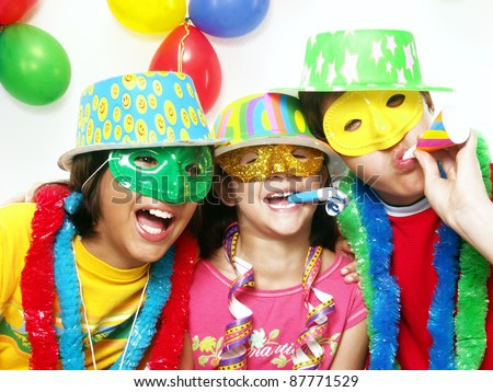 Three funny carnival kids portrait